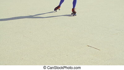 Close Up of Girl Riding Roller Skates