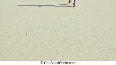 Close Up of Girl Riding Roller Skates