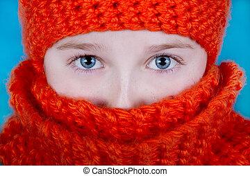 close-up of girl wearing orange hat