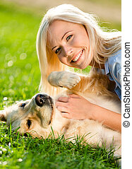 Close up of girl who strokes retriever