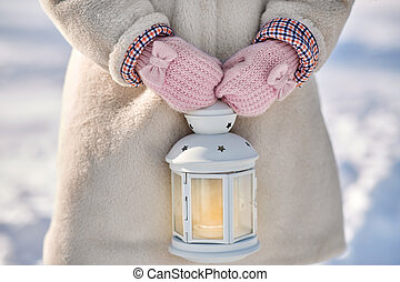 close up of girl with christmas lantern in winter