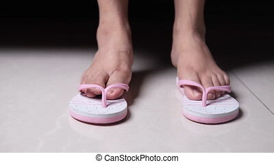 close up of girls feet wearing sandal indoor