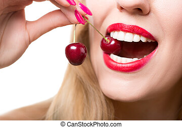 girl's lips and tongue licking two berries