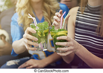 Close up of girls with drinks