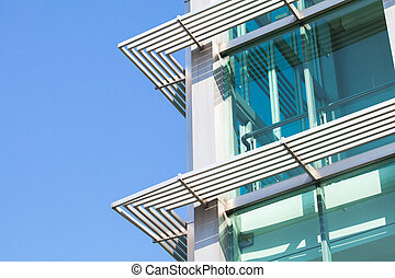 Close-up of glass building with windows reflected to the sky