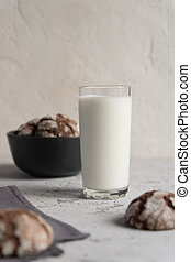 close up of glass of milk with crispy crunchy chocolate cookies. Tasty snack or breakfast
