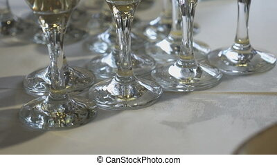 Close-up of glasses of sparkling wine on table during...