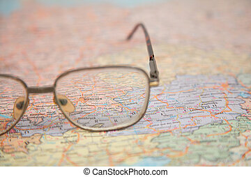 close-up of glasses on map of europe