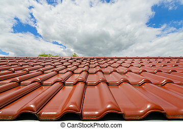 Close-up of glazed brown roof tiles