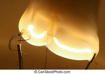 Close up of glowing light bulb thread