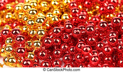 Close up of gold and red beads.