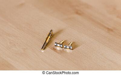 close-up of gold men's cufflinks