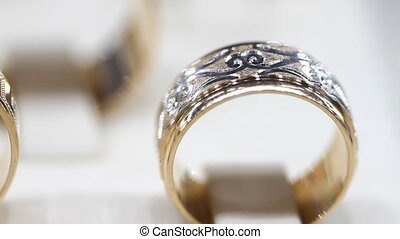 Close up of gold rings with slider