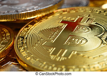 Close up of golden coins with bitcoin symbol.