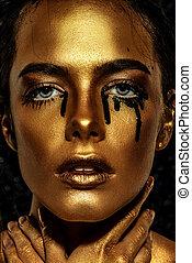 close-up of golden face