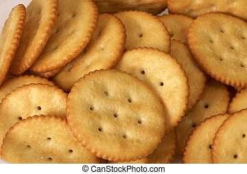close up of golden round butter crackers