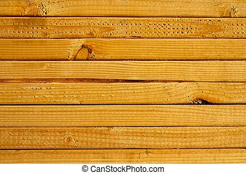Close-up of grain on stacked lumber.
