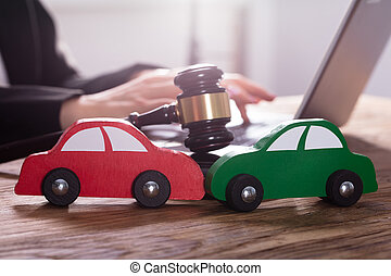Close-up Of Green And Red Car On Wooden Desk