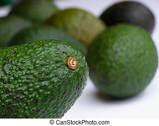green avocado - Close-up of green avocado on white...