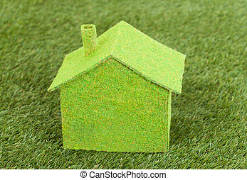 Close-up Of Green Ecological House On Green Grass