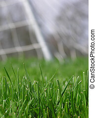 soccer net - Close-up of green grass with soccer net in the ...