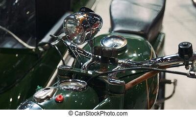 Close up of green motorcycle steering wheel