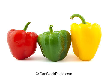 Close up of green, red and yellow fresh peppers on white background.