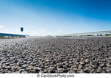 Close up of grey asphalt of a country road in Sardinia