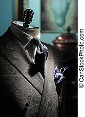 Close-up of grey checkered jacket with white checkered shirt...