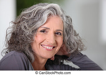 Close-up of grey haired woman at home