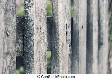 Close up of grey wooden fence panels