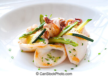 Macro Close up of grilled calamari and green asparagus.