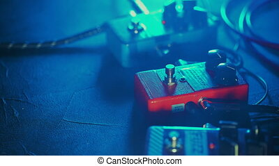 Close up of guitar player or rock musician playing fuzz,...