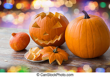 close up of halloween pumpkins on table