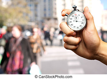 Close Up Of Hand Holding Stopwatch