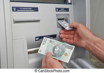 hand of a man using banking machine