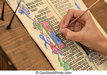 Close-up of hand of medieval manuscript scribe - calligraphy