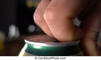 Close up of hand opening a beer can, slow motion