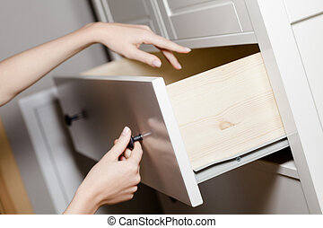 Close up of hand opening a drawer