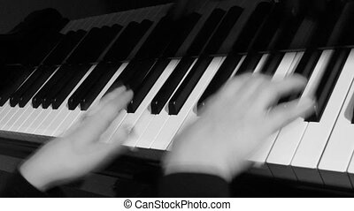 close up of hand playing piano