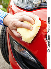 Close Up Of Hand Polishing Car Using Cloth