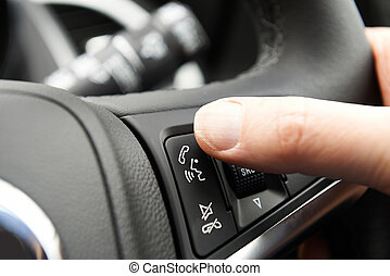 Close Up Of Hand Pressing Car Bluetooth Control On Steering...