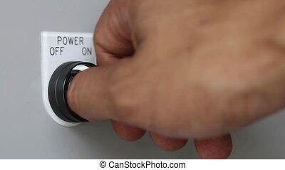 hand turn on machine power switch - Close-up of hand turn on...