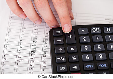 Close-up Of Hand With Calculator
