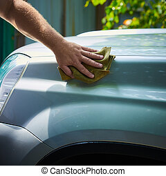 Close-up Of Hand With green Brush Washing Car