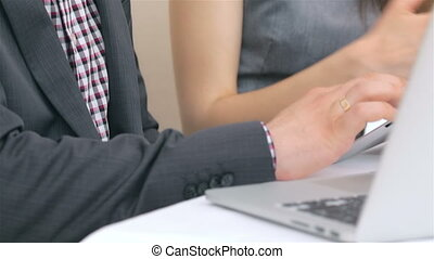 Close-up of hands and face young attractive business man and woman