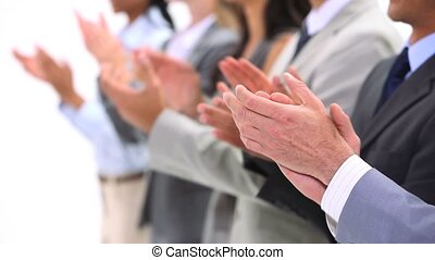 Close-up of hands applauding against a white background