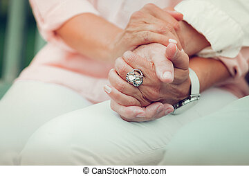 Close up of hands being held together