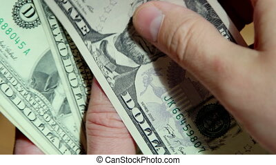 Close up of hands counting dollar bills. UltraHD footage