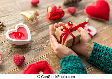 close up of hands holding christmas gift